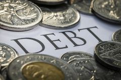 Canadian Cash with the Word Debt in the Middle.  stock image
