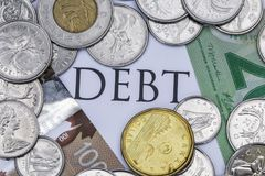 Canadian Cash with the Word Debt in the Middle.  royalty free stock images