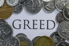 Canadian Cash with the Word Greed in the Middle.  royalty free stock images