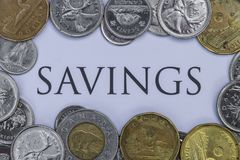 Canadian Cash with the Word Savings in the Middle.  stock images