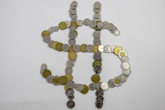 Canadian Change arranged in the shape of a money sign angled Stock Photos
