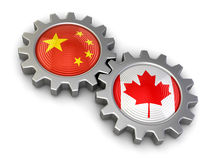 Canadian and Chinese flags on a gears (clipping path included) Stock Photos
