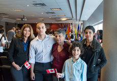 Canadian Citizenship Ceremony. TORONTO,CANADA-AUGU ST 27,2014: Hispanic family becomes Canadian citizens.Canadian nationality law determines who is granted to. A Royalty Free Stock Photography