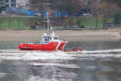 Canadian Coast Guard and Canoers Royalty Free Stock Photos