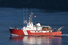 Canadian Coast Guard Vessel. A Canadian Coast Guard vessel from Fisheries and Oceans flies a Canadian flag Royalty Free Stock Photography