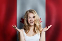 Canadian Concept With Happy Surprised Cute Girl With Canada Background. Travel And Education Concept Royalty Free Stock Image
