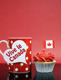 Canadian cupcake with maple leaf flag Royalty Free Stock Photography