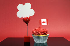 Canadian cupcake with maple leaf flag and sign Royalty Free Stock Image