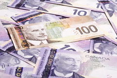 Canadian currency. Background, 10 and 100 Dollar bill Royalty Free Stock Photos