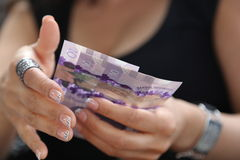 Canadian currency. Classy lady hands holding Canadian money Royalty Free Stock Photo