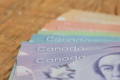Canadian currency. Dollars. Close up of cash bills on rustic wood table. Canadian currency. Dollars. Money from Canada. Close up of cash bills on rustic wood stock photography