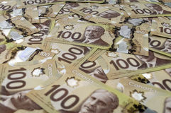 100 Canadian dollar banknotes. Close up view of new 100 Canadian dollar banknotes Royalty Free Stock Photography