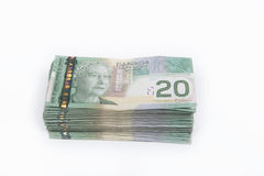 Canadian 20 dollar bill. A lot of Canadian twenty dollar bills isolated on a white background Stock Images