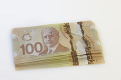 Canadian 100 dollar bill. A lot of Canadian twenty dollar bills  on a white background Royalty Free Stock Photo