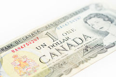 Canadian Dollar. Close up Photograph of an older kind of Canadian One Dollar banknote, bright style, buck, bill dollars Stock Photos