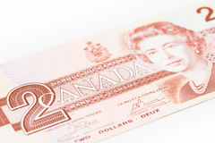 Canadian Dollar. Close up Photograph of an older kind of Canadian Two Dollars banknote, bright style, buck, bill dollars Royalty Free Stock Image