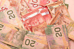 Canadian dollar notes. A lot of twenty, fifty and hunder Canadian dollar bills scattered Royalty Free Stock Photography