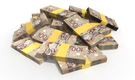 Canadian Dollar Notes Scattered Pile. A pile of randomly scattered wads of Canadian Dollar banknotes on an isolated background Stock Image