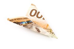 Canadian dollar paper airplane Stock Photo