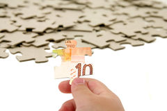 Canadian dollar and  puzzle Stock Images