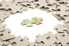 Canadian dollar and  puzzle Royalty Free Stock Photo
