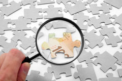 Canadian dollar puzzle and magnifier Stock Photo