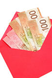 Canadian dollar and red envelope Royalty Free Stock Photo