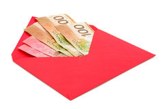 Canadian dollar and red envelope Stock Photography