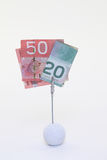 Canadian Dollars. Clipped over a golfball Royalty Free Stock Photos