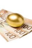 Canadian dollars. Golden egg and canadian dollars, concept of Making Money Royalty Free Stock Photo