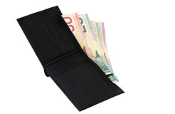 Canadian dollars. Leather wallet full of Canadian banknotes isolated Royalty Free Stock Images