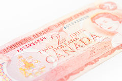 Canadian Dollars. Close up Photograph of an older kind of Canadian Two Dollars banknote, bright style, buck, dollars, bill Royalty Free Stock Photos