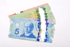 Canadian dollars Currency bank notes on white. Background Royalty Free Stock Images