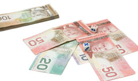Canadian dollars with dice Stock Photos