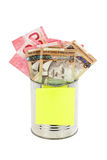 Canadian dollars and tin Stock Images