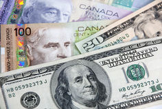 Canadian Dollars vs US dollars. In close-up shot Stock Images