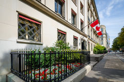 Canadian Embassy in Paris, France. PARIS, FRANCE AUGUST 17, 2015 The Canadian flag flies outside its embassy on Montaigne Avenue in the Champs-Elysees district Stock Image