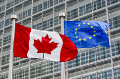 Canadian and European flags. Waving in the wind (montage stock images