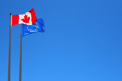 Canadian and European flags. Waving in the wind (montage royalty free stock photo