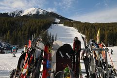 Nakiska skiing slops with skiing and snowboarding gears. stock photos