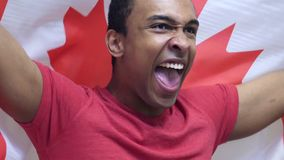 Canadian Fan Celebrating while holding the Flag of Canada in Slow Motion