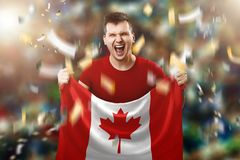 Canadian fan, fan of a man holding the national flag of Canada Mixed media