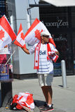 Canadian fans arrive to BC Place Stadium. VANCOUVER, CANADA - JUNE 27, 2015: Canadian fans arrive to BC Place Stadium for FIFA Women's World Cup Canada 2015 Royalty Free Stock Photo