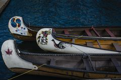 Canadian first nation canoes on water. With beautiful colorful symbols stock photo