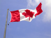 Canadian flag. A canadian flag flapping in the wind from niagara falls Royalty Free Stock Images
