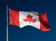 Canadian Flag. On blue skys in the wind Royalty Free Stock Photo