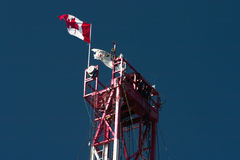 Canadian flag. A Canadian flag high on top of a drilling rig Stock Images