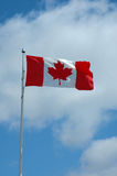 Canadian Flag. With blue sky background and clouds stock photos