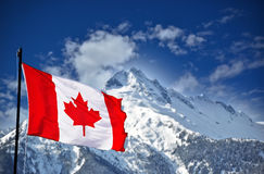 Canadian flag and beautiful landscape Royalty Free Stock Image
