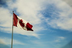 Canadian Flag blue sky background Royalty Free Stock Photo